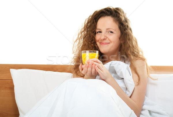 Gelukkig vrouw bed glas sinaasappelsap Stockfoto © pekour