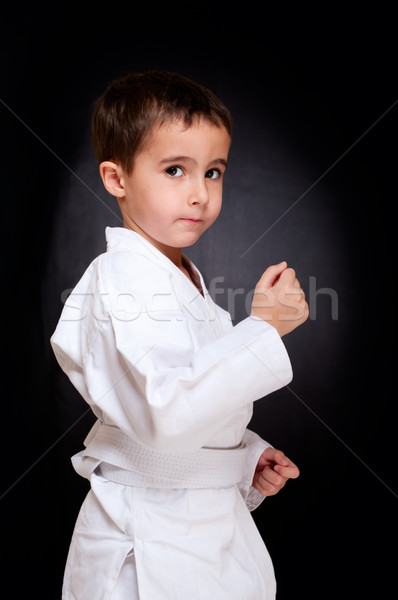 Karate boy sitting in white kimono Stock photo © pekour
