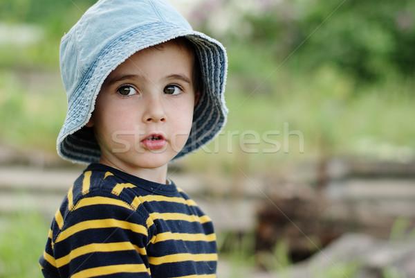 Pequeno menino jeans seis ao ar livre Foto stock © pekour