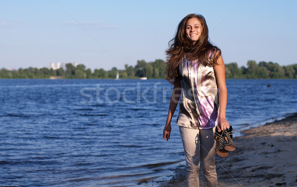 Happy barefoot girl on the beach Stock photo © pekour