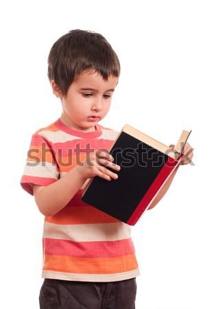 Kicsi fiú olvas könyv izolált fehér Stock fotó © pekour