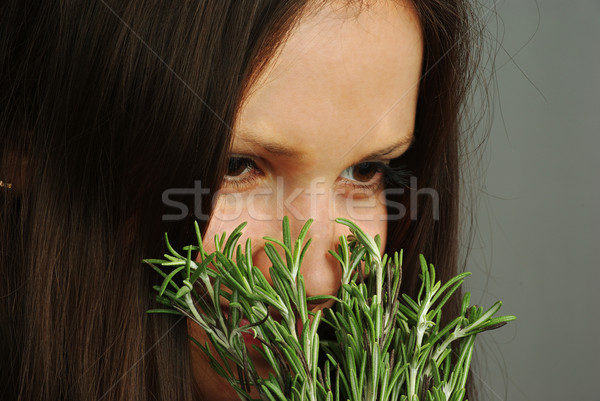 Girl sniffing rosemary Stock photo © pekour