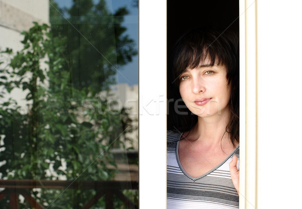 Beautiful brunette woman looking from the balkony Stock photo © pekour