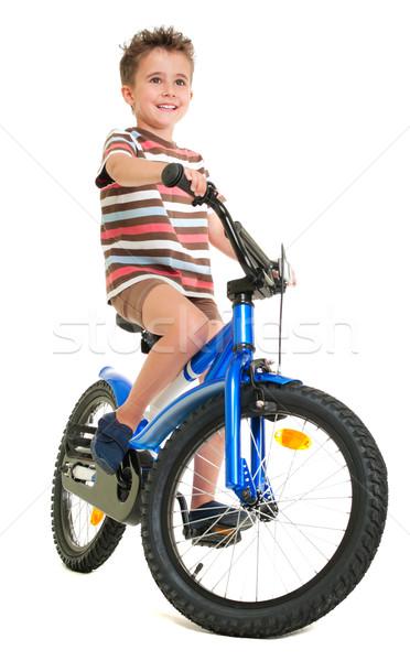 Boldog kicsi fiú bicikli izolált fehér Stock fotó © pekour