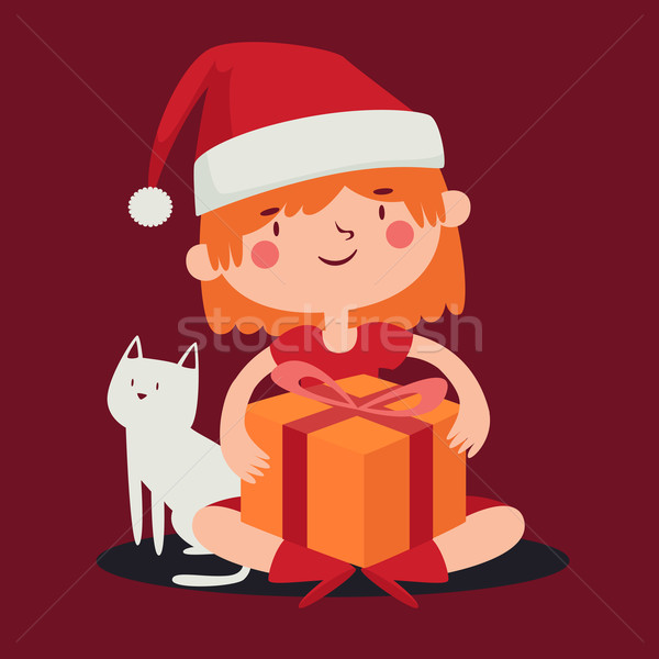 Christmas Girl Holding a Present next to her Pet Cat Stock photo © penguinline