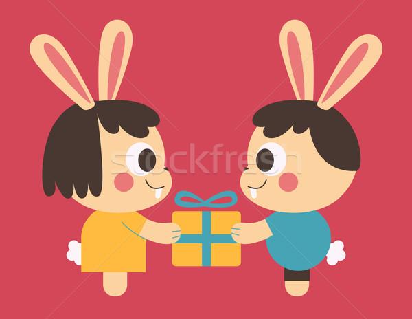 Bunny Couple Trading a Present Stock photo © penguinline