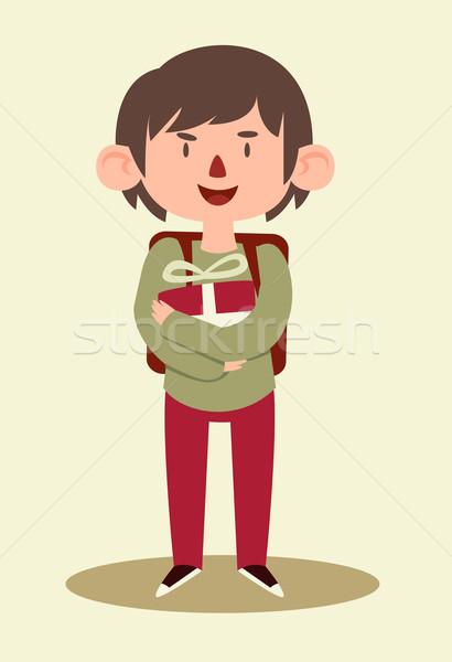 Iskolás fiú tart ajándék rajz fiú visel Stock fotó © penguinline