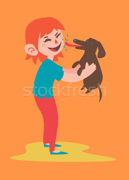 Happy Girl Holding her Dog Stock photo © penguinline