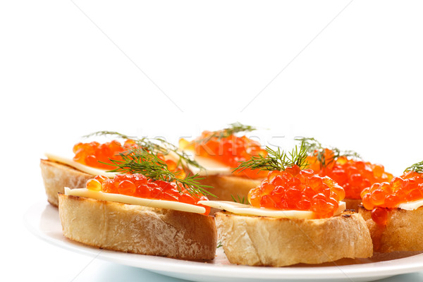Szelet kenyér piros kaviár fehér háttér Stock fotó © Peredniankina