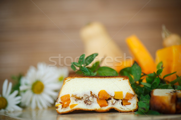 Stock photo: Cottage cheese casserole with slices of pumpkin and nuts
