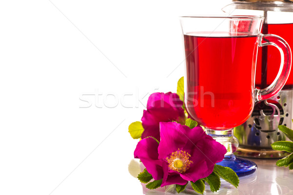 Stock photo: tea with rose hips with flowers