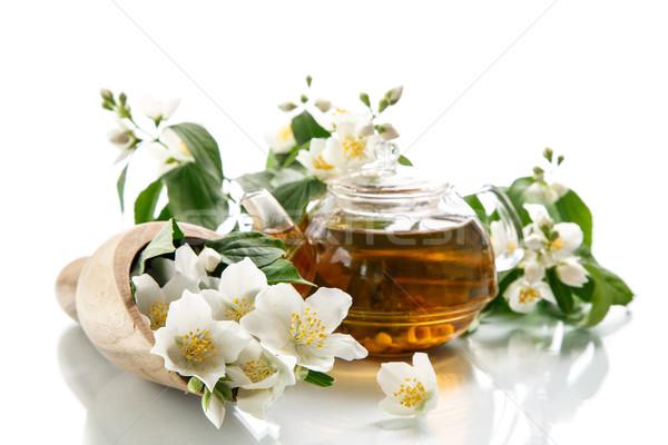 jasmine tea in a teapot with a branch of jasmine  Stock photo © Peredniankina