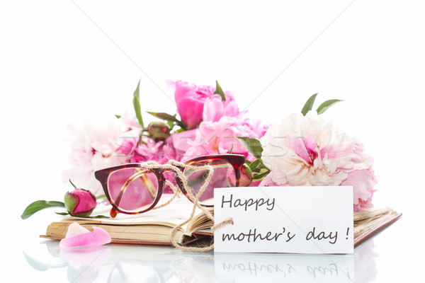 bouquet of peonies  on old book with glasses Stock photo © Peredniankina