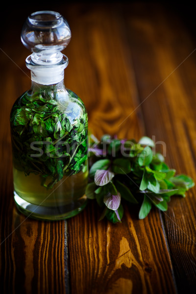 Mint syrup in a glass bottle Stock photo © Peredniankina