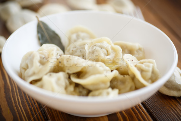boiled dumplings with meat in a white plate Stock photo © Peredniankina