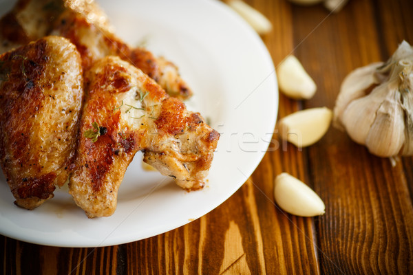 fried chicken wings with garlic  Stock photo © Peredniankina