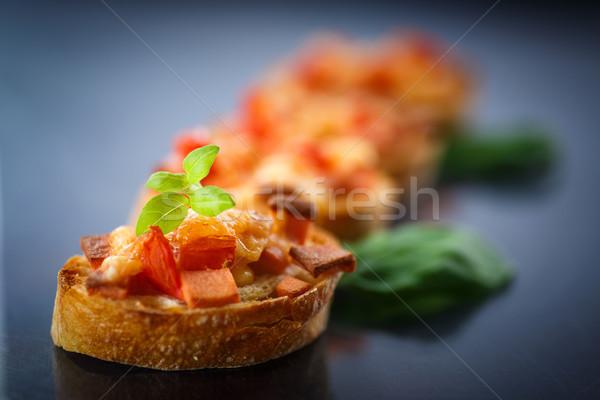 Bruschetta queso tomates negro fondo carne Foto stock © Peredniankina
