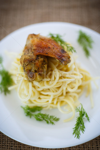 Chicken wings fried with noodles Stock photo © Peredniankina