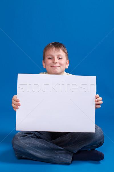 boy holding a blank Stock photo © Peredniankina