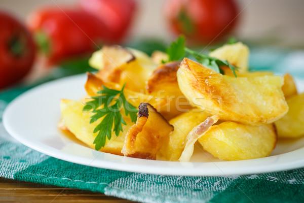 Foto stock: Frito · patatas · rebanadas · tocino · mesa · de · madera · comer