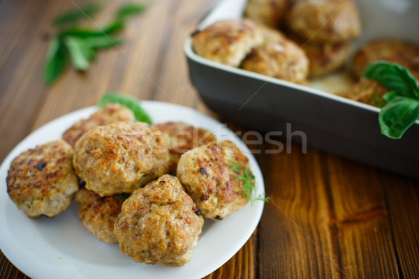 fried cutlet in ceramic form Stock photo © Peredniankina
