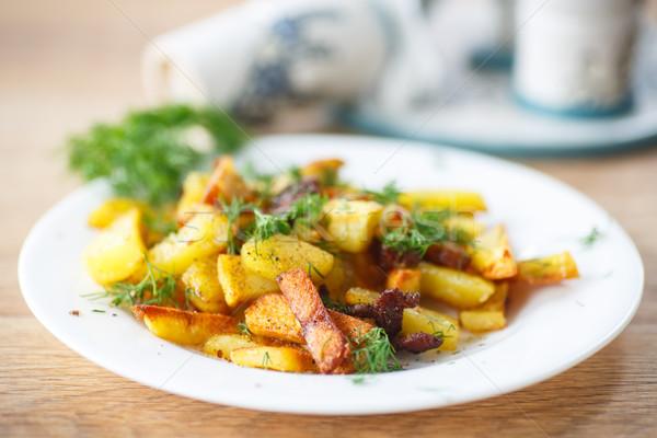 Stok fotoğraf: Patates · domuz · pastırması · tablo · yeşil · siyah