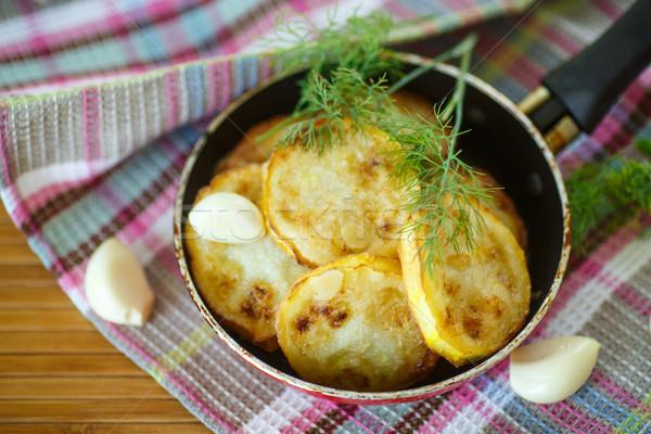 Zucchini Scheiben Butter Knoblauch Essen Stock foto © Peredniankina