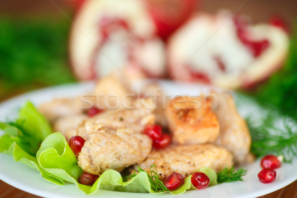 roasted chicken with pomegranate seeds Stock photo © Peredniankina
