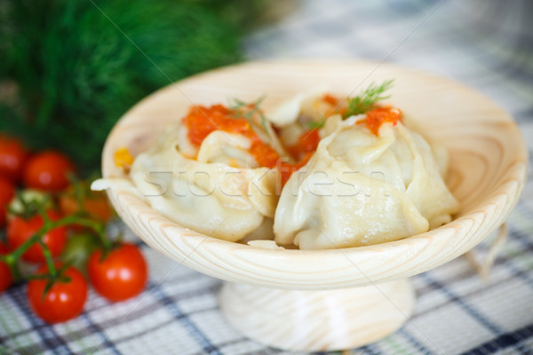 large boiled manti in the wooden saucer Stock photo © Peredniankina