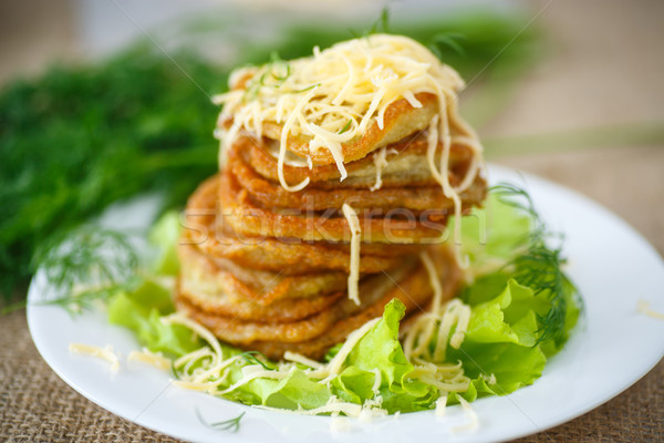 Stock photo: fried potato pancakes with cheese