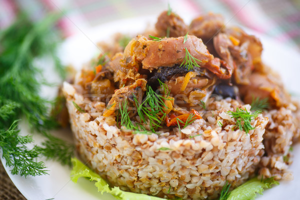 Stock photo: Boiled buckwheat with stewed chicken gizzards