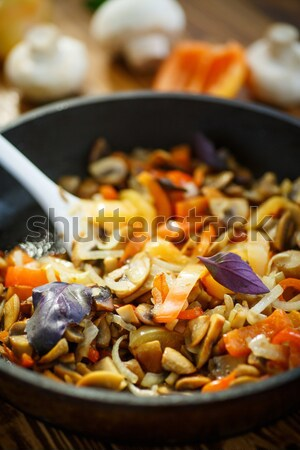 fried mushrooms with peppers and onions Stock photo © Peredniankina
