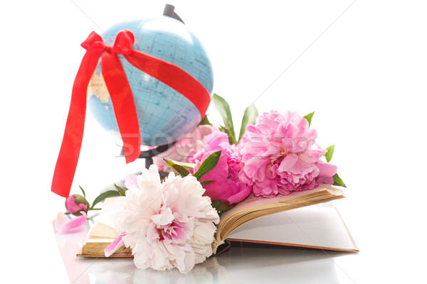 Pink peonies in the open book and globe Stock photo © Peredniankina
