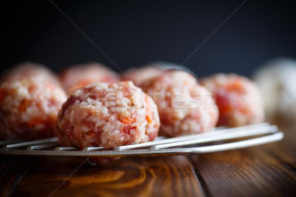 raw meatballs tangled meat with carrots Stock photo © Peredniankina
