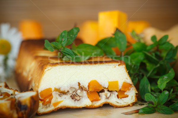 Cottage cheese casserole with slices of pumpkin and nuts Stock photo © Peredniankina