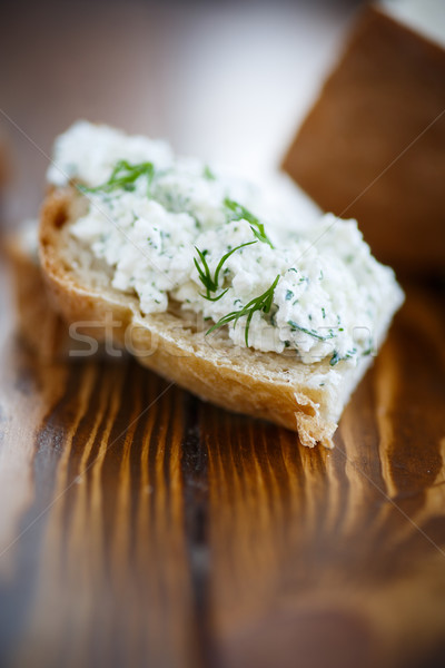 Tuzlu peynir otlar sandviçler ahşap masa Stok fotoğraf © Peredniankina