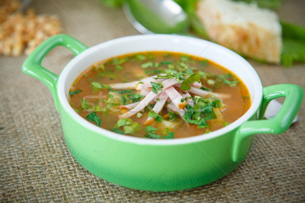 pea soup with smoked meat Stock photo © Peredniankina