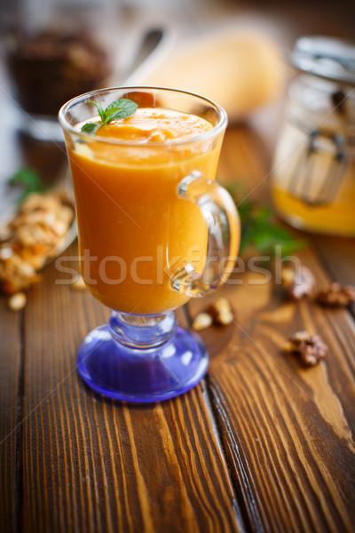 тыква льстец орехи меда деревянный стол фрукты Сток-фото © Peredniankina