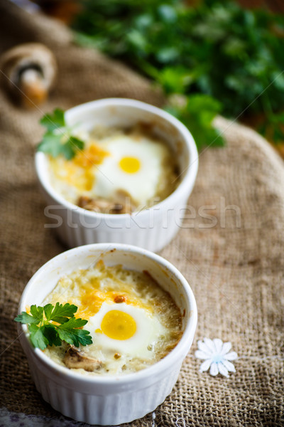 Baked egg with minced fish and mushrooms Stock photo © Peredniankina