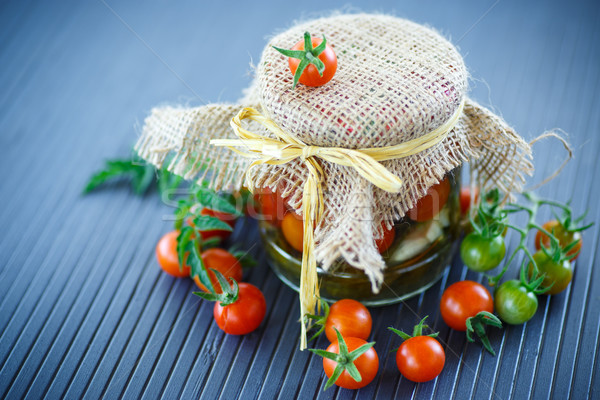 Stock photo: tomatoes marinated in jars