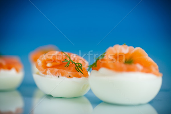 boiled eggs with salt red fish Stock photo © Peredniankina