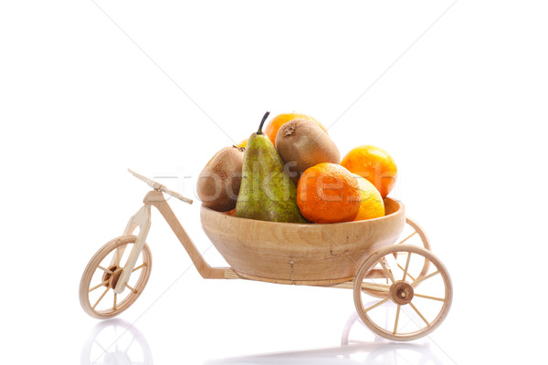 Taze meyve üç tekerlekli bisiklet ahşap bisiklet bisiklet beyaz Stok fotoğraf © Peredniankina