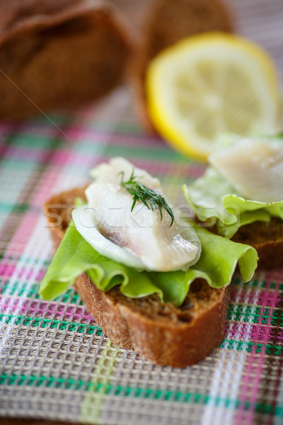 sandwich salted herring and lettuce Stock photo © Peredniankina