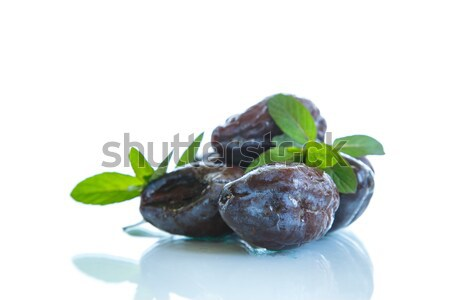 dried plums with a sprig of mint  Stock photo © Peredniankina