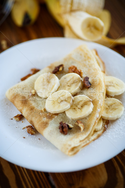 sweet pancakes with bananas and nuts  Stock photo © Peredniankina