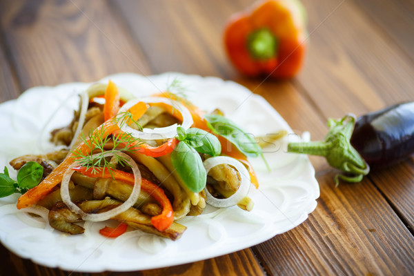 warm salad of roasted eggplant with peppers Stock photo © Peredniankina