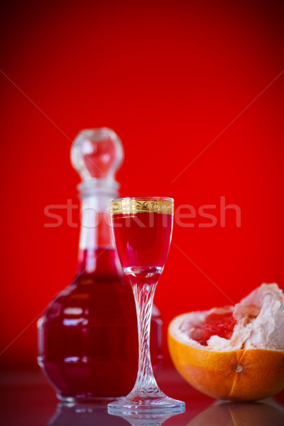 sweet grapefruit alcoholic cordial in the decanter with a glass Stock photo © Peredniankina