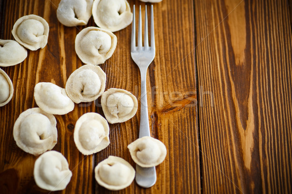 Brut ravioli viande table en bois fond cuisine Photo stock © Peredniankina