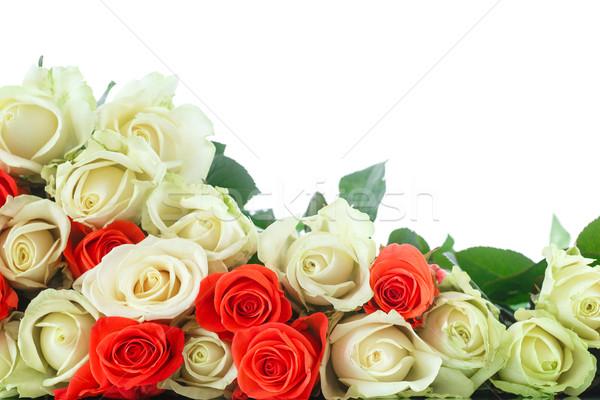 Buket kırmızı sarı güller beyaz çiçek Stok fotoğraf © Peredniankina