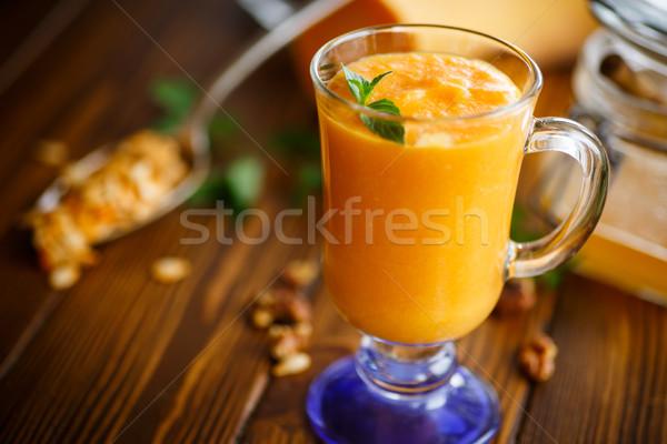 Sütőtök smoothie diók méz fa asztal gyümölcs Stock fotó © Peredniankina